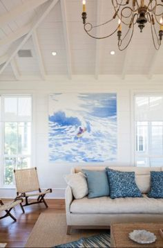 Coastal Living Sullivan's Island Home Tour: The living room, designed by Jenny Keenan, headlined by a surf painting by artist Isca Greenfield-Sanders.