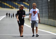 Sebastian Vettel and Britta Roeske Photos Photos - Sebastian Vettel of Germany and Red Bull Racing walks the track with his press officer Britta Roeske during previews to the Brazilian Formula One Grand Prix at the Interlagos Circuit on November 4, 2010 in Sao Paulo, Brazil. - F1 Grand Prix of Brazil - Previews