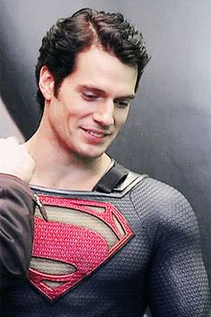 Putting on the cape. Henry Cavill