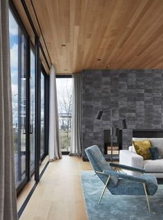 Living Room looking North St Joseph Beachfront Home by Wheeler Kearns Architects. Browse inspirational photos of modern homes. From midcentury modern to prefab housing and renovations, these stylish spaces suit every taste. Wood Roof Shingles, Wood Siding, Wood Ceilings, Floor To Ceiling Windows, Black Window Frames, Shiplap Wood, Wood Cladding, White Oak Floors, Lakefront Homes