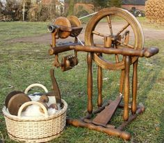 spinning wheel:  uh.....would you call that a castle wheel????  Look at the orifice and bobbin on that baby!!  That is for some chunky yarn!!!