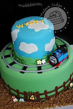 Thomas going around cake