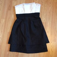 BCBG black and white strapless dress ADORABLE black and white BCBG dress, sadly I did not try it on before I bought it and it didn't fit so this beauty has NEVER been worn! BCBGMaxAzria Dresses Strapless