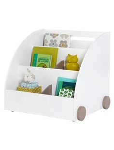 This shelf unit is designed especially for arranging books or comic books facing outwards so they're easier to find. SIZE:  Height 59 cm, width 63.6 c