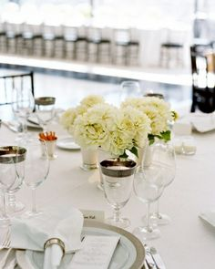 Classic Centerpiece Bunches of white flowers in small groupings make for a striking tablescape.