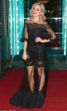 Sheer daring: Pixie Lott looked incredible in a dramatic, see-through black gown as she attended the opening night of Breakfast At Tiffany's in Leicester on Thursday