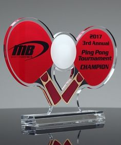 "Choose our Custom Ping Pong Award to recognize your top performers.  This award can be completely customized in size, shape and color. Constructed from 3/8"" thick premium acrylic and elevated atop a wide slant base. Shipping is available to the entire USA!"