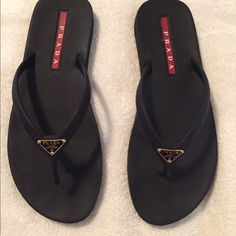 PRADA BLACK RUBBER FLIP FLOPS THONGS *need repair* Really awesome shoes - they were so comfortable. I only had them about a month and then I broke them.  I do not have a good shoe repair person that I know of so I just bought another pair. I love these shoes and anyone can tell at a glance they are Prada with the beautiful logo on the front and the nice red Prada inset on the back! Prada Shoes Sandals