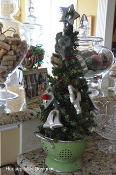 Colander Tree Skirt - how fun in the kitchen!  Love the vintage cookie cutters