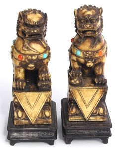 A Pair Chinese Carved Ivory Foo Dogs with Turquoise and Amber. 19th c.