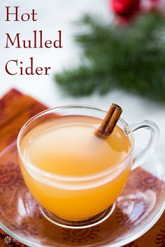 Hot Mulled Cider ~ Classic hot mulled cider! Spicy apple cider cooked with a clove-studded orange, cinnamon, allspice, nutmeg, cardamom and brown sugar. On SimplyRecipes.com