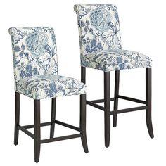 Picnic in a field of flowers without getting pollen on your palazzo pants. Hand-upholstered in a durable poly-linen blend with a traditional Jacobean floral print in indigo, the Angela Bar Stool and Counter Stool also feature a tight, self-welted seat, classic rolled back and sturdy hardwood frame.