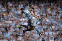 Arsenal's French striker Giroud jumps for a header with Manchester City's Argentinian defe...