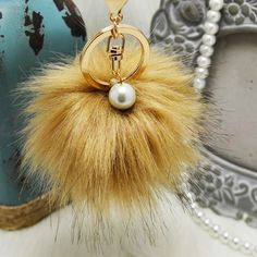 Coffee Faux Fox Fur Pom Pom keychain with pearl NWOT! Brand new!! Faux fox fur but really soft and great quality. Gold hardware.  Size: (approx) Ball Diameter = 8cm  Its a keychain, you can also use it to put as purse charm or just to hold any key.  Great gift for your family, friends or your self.  ** color might be slightly different cause of the lightning  Great for your Louis Vuitton, Prada, Fendi, Chanel, Michael Kors, Gucci, Coach Tory Burch, Kate spade, Marc jacobs and others…
