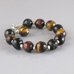 Hey, I found this really awesome Etsy listing at https://www.etsy.com/listing/90681972/tiger-eye-agate-gemstone-sterling-silver
