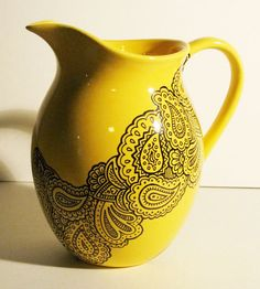 Hey, I found this really awesome Etsy listing at http://www.etsy.com/listing/112053140/hand-painted-paisley-on-a-bright-yellow