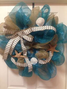 Beachy decomesh wreath sand and water with starfish and sandollars and chevron ribbon