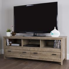 Console features one large storage drawer two cabinets and shelving