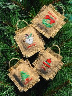 Make your gift special! Make it handmade! These 3 X 3 1/2 rustic Christmas ornaments will brighten anyones tree. The set includes a snowman, a wreath, a bell and a Christmas tree. They are hand cross stitched on burlap with just a touch of sparkle and filled with natural fibers. There is a cheery message on each of these ornaments, but I can stitch whatever message you want to say, even personalize them with a name. (Providing it fits on the ornament) Just convo me with the order! Give t...