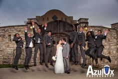 Groomsmen Jump in the air while the bride and groom kiss. Fun idea for formal portraits  see more of our work at www.azulox.com