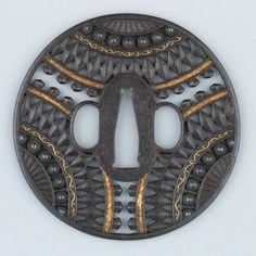 Late 17th century tsuba with nice geometric design. (Fan details maybe?) Iron, gold, silver and copper http://www.metmuseum.org/collection/the-collection-online/search/35141