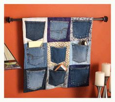 Up-cycled pocket wall hanging for small toys. How cute is this? You could even make one for cell phones and cell phone chargers. Fun. A good use for all those jeans that don't fit because you lost all that weight, eh? #ilovejeans #homeorganization