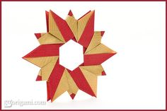 Another sweet modular origami wreath. Instructions found HERE at Go Origami ! Origami Wreath, Origami 3d, Origami Decoration, Modular Origami, Origami Stars, Christmas Origami, Christmas Crafts, Christmas Decorations, Origami Flowers Tutorial