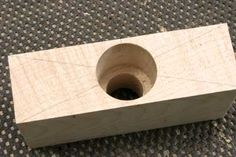 Sawtooth or forstner bits will leave a clean and accurate hole