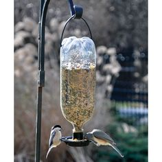 This simple, easy-to-use bird feeder fits any size plastic bottle with a standard cap size. Just attach the included hanger, fill with bird seed, s. Bird Seed Feeders, Bird Feeder Craft, Humming Bird Feeders, Homemade Bird Houses, Homemade Bird Feeders, Reuse Plastic Bottles, Plastic Bottle Crafts, Bird Aviary, Bird Crafts