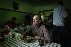 Henryk, 58, eats his meal at the Camillian Mission shelter for homeless people in Warsaw where he has lived for five years, 2013 - by Kacper Pempel, Polish