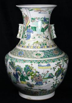 """Chinese famille verte porcelain arrow vase, the trumpet neck decorated with officials flanked by tubular bamboo form handles, above a diaper band with flowers and the 'four arts', having a compressed body with warriors on horse back, with apocryphal Kangxi mark, 21.5""""h"""