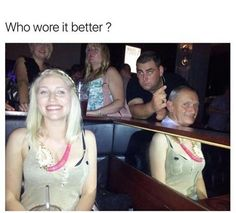 Woman smiling in a photo and a mirror makes it look like the man in the booth next to her is wearing a dress.