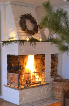 corner fireplace - love the white painted brick!