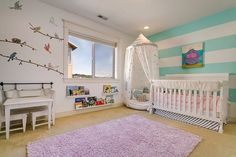 Fun and bright nursery design for the baby girl