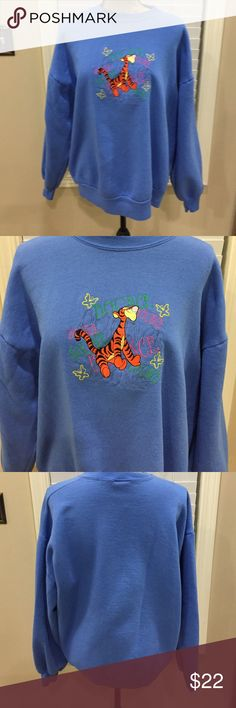 """🐯Tigger-100 acres collection sweatshirt! 🎈❤️️ 🐯Tigger-100 acres collection sweatshirt! 🎈❤️️. Lovely sky blue sweatshirt with Tigger and """"Bounce bounce bounce bounce"""" on the front. Super cute and fun! Show some Disney love!! Preloved in excellent condition. Pit to pit measurement is 24"""". Length 27"""". Disney Tops Sweatshirts & Hoodies"""