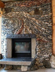 Fire place. Getting crazy with stones in a mosaic pattern!