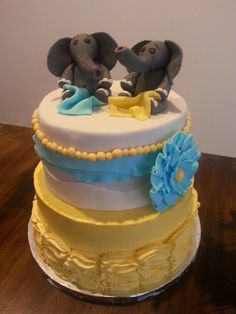 Twin baby shower cake with elephants  ruffles made by @Christin Cousins  https://www.facebook.com/photo.php?fbid=632001616880065set=pcb.632001663546727type=1theater