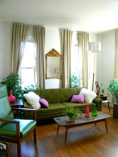 I love that olive green vintage inspired sofa!