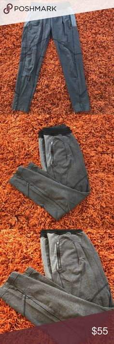 Lululemon Athletica Joggers Lululemon Athletica Joggers pockets with zippers Perfect Condition besides for inside tag removed because it was itchy! lululemon athletica Pants Track Pants & Joggers