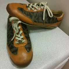 Michael Kors monogram sneakers 🅿🅿 & M E r c a r ii price lower  Authentic Michael Kors monogram sneakers  Gently used MICHAEL Michael Kors Shoes Sneakers