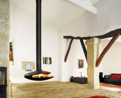 Iconic Hanging Fireplace As Focal Point Of Traditional Living Room