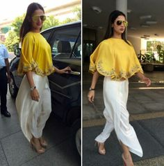Sonal Chauhan wearing Jayanti Reddy in a yellow poncho and white dhoti pants