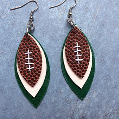 Hey, I found this really awesome Etsy listing at https://www.etsy.com/listing/553776917/gameday-green-and-white-leather-earrings