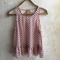 HP!  Forever 21 sheer blouse with polka dots Sheer pale pink blouse with navy dots, perfect for spring/summer! Sleeveless with a tieback and adorable ruffle bottom. From Forever 21. Size L, runs slightly small. Worn twice, in like new condition. Forever 21 Tops
