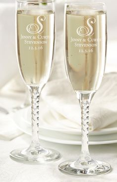 "Toast to love and happiness with these classic champagne flutes. They can be personalized for that individual touch. Glasses are sold in sets of two, hold 5.75 oz and measure 8"" tall."