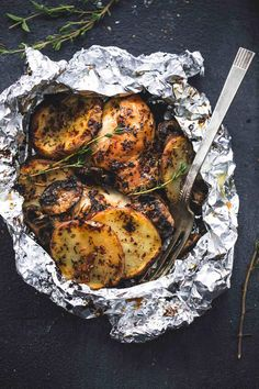 Grilled Herbed Chicken and Potato Foil Packs  - CountryLiving.com