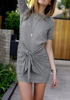 Feel extra comfy in this grey knot-front jersey dress. It features an adjustable…