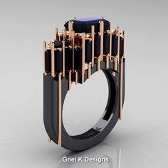 Exclusive, luxurious and rich, this Modern Gothic 14K Black Rose Gold Emerald and Baguette Black Diamond Cathedral Wedding Ring R424-14KBRGBD by Gnel K Designs evokes absolute glamour and elegance. All sizes are available.  Includes: * 1 x over 10.0 grams TW (approx) of solid 14K black and rose gold ring (black rhodium coat on 14K rose gold) * 24 x baguette cut 0.17 carat (approx 4.0 TCW) lab created black diamonds * 1 x emerald cut 2.62 carat lab created black diamond * Ring Size 7 United…