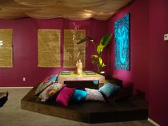 Magenta Teal Gold Dharma dinning area / tea room with pillows. Earth tones and natural wood elements.