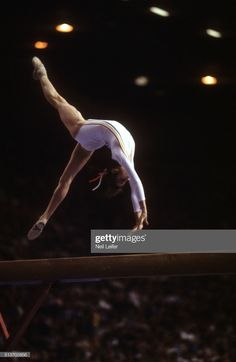 Romania Nadia Comaneci in action on the balance beam during Women's competition at Montreal Forum. Montreal, Canada - Neil Leifer ) Get premium, high resolution news photos at Getty Images All About Gymnastics, Elite Gymnastics, Artistic Gymnastics, Olympic Sports, Olympic Games, Nadia Comaneci 1976, Neil Leifer, Life In Usa, Balance Beam